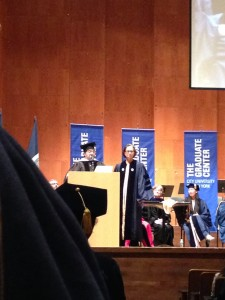 Davis in navy blue doctoral robes, on the stage at Avery Fisher Hall.