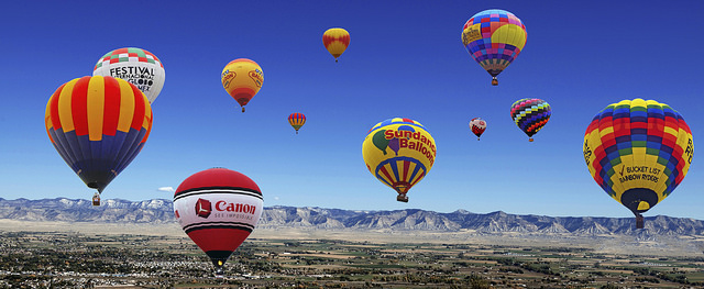 Hot air balloons in flight over Colorado.