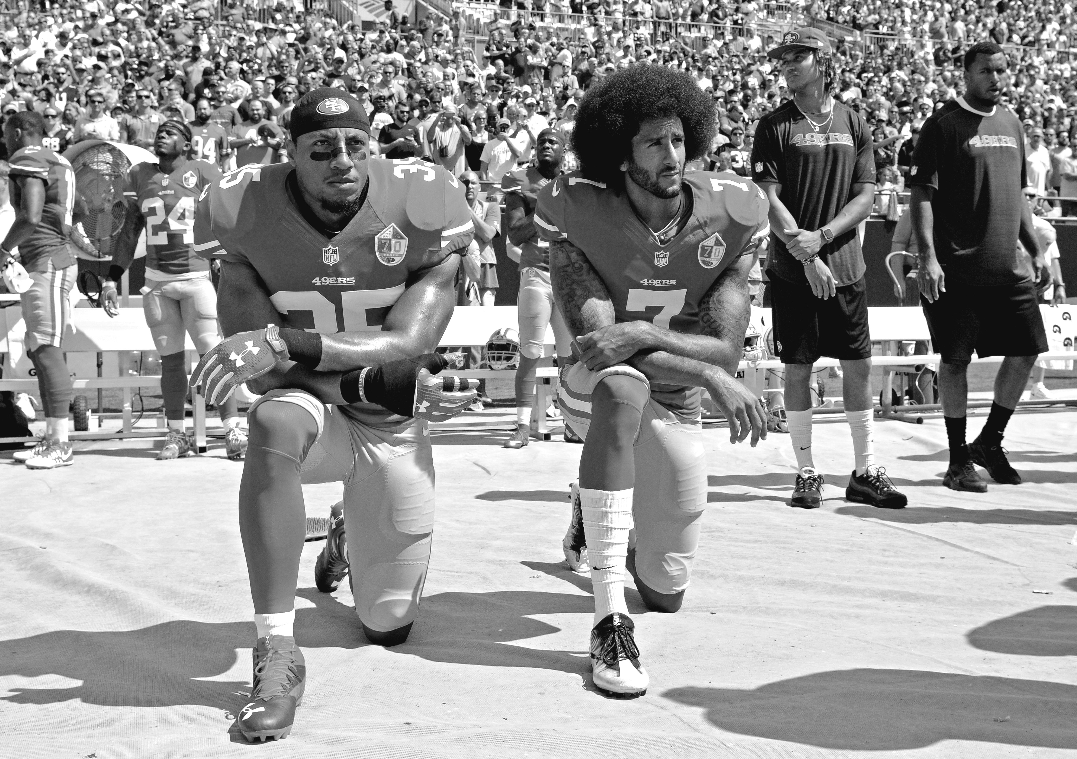 San Francisco 49ers' Colin Kaepernick (7) and Eric Reid (35) kneel during the national anthem before an NFL football game against the Carolina Panthers in Charlotte, on Sunday, Sept. 18.(AP Photo/Mike McCarn)
