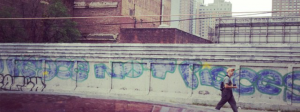 "Graffiti near 11th avenue and 34th Street that reads: ""Peace not Pieces"""