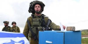 An IDF soldier casts his ballot during the recent election.